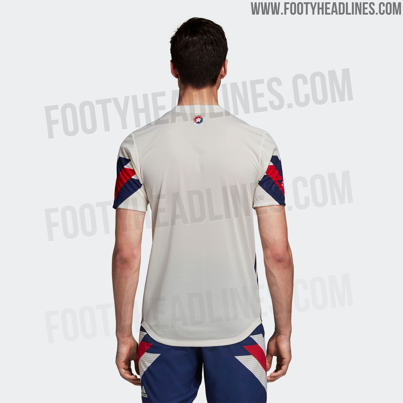 88a20348b57 The shorts of the Adidas MLS All-Star 2018 kit are navy with classic bold  1990s white   red Three Stripes