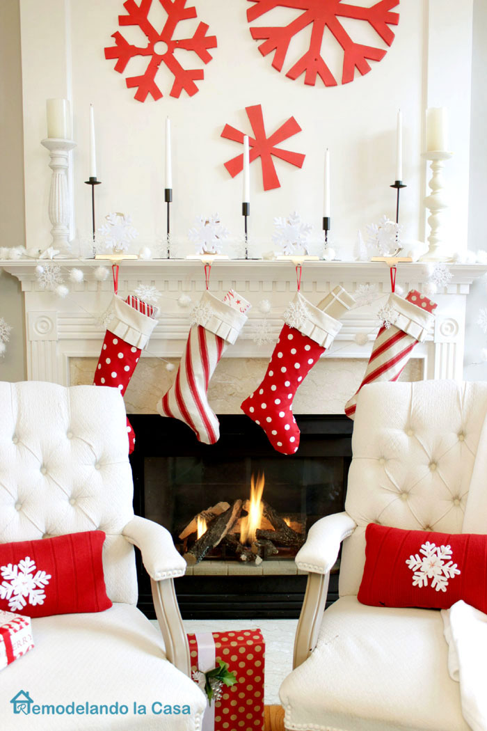 red and white Christmas mantel with snowflake art, candles and polka dots