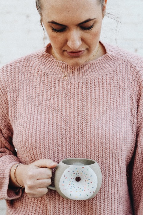 gold horn necklace pink sweater donut mug