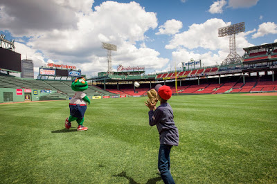 Andrew Pires and Wally play catch on the field at Fenway!