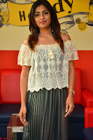 Eesha in a cute deep neck top and Skirt at at Big FM 055.JPG