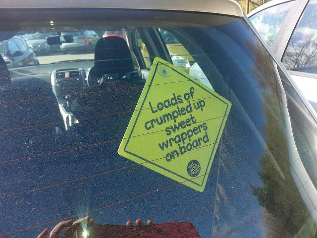 amusing car sign in car window