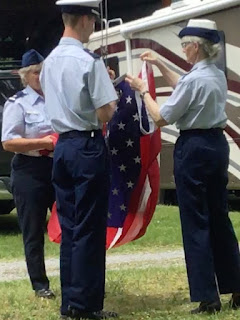 Stillwell Jennings Beehm prepare American ensign