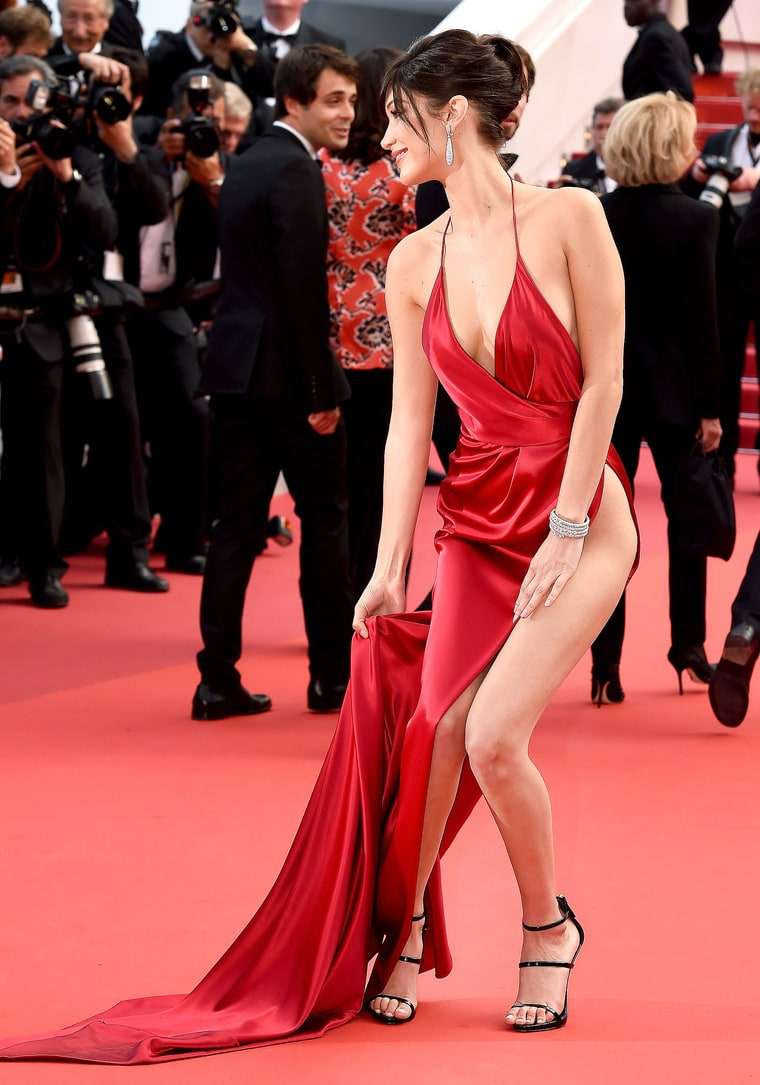 The same thing happened to her exactly one year ago during the 69th annual Cannes Film Festival as she entered the screening for The Unknown Girl. Hadid, in a memorable red halter Alexandre Vauthier gown also with a high-slit and plunging neckline, suffered the same malfunction.