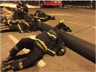 "Viral photos of tired firemen spark praise for ""heroes"""