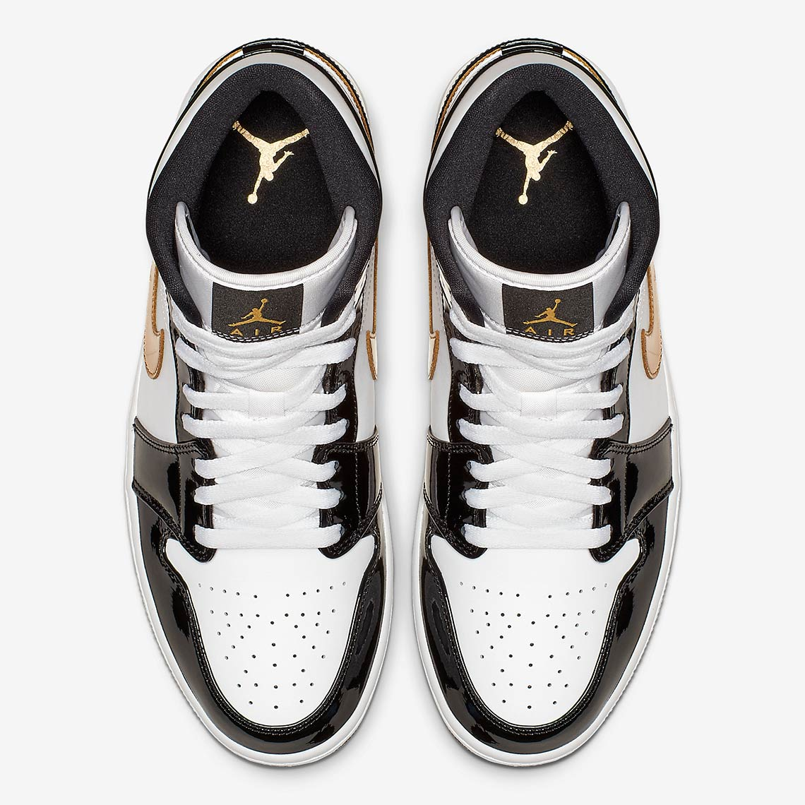 sports shoes f2c32 3ebdf An all-black patent leather Air Jordan 1 Mid hit stores earlier in  December, and now the 1 Mid has received a black gold white color scheme  that offers ...