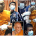 The grin reaper: Buddhist monk appears to SMILE as his body is exhumed two months after his death so his clothes can be changed in Thailand