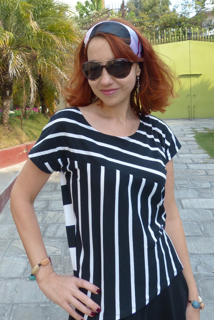 Black and white stripy top, head scarf and sunglasses