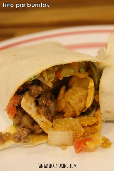 Frito Pie Burritos // Frito pies can be for Taco Tuesday too with this yummy burrito recipe! #recipe #fritos #beef #burrito
