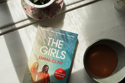 Typewriter Teeth The Girls Emma Cline Book Review  image of book with a cup of tea