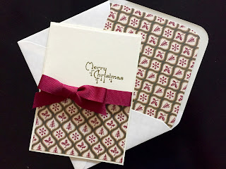Hand made Christmas card with grosgrain bow, stamped greeting and matching envelope