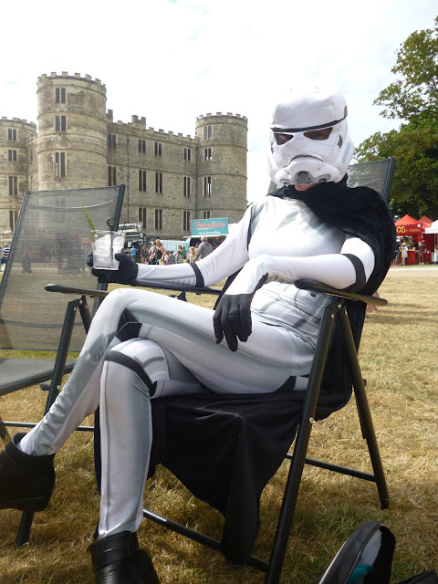 camp bestival storm trooper enjoying a gin