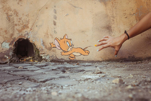 street art by ernest zacharevic in rome italy - sixth most popular mural of august 2013