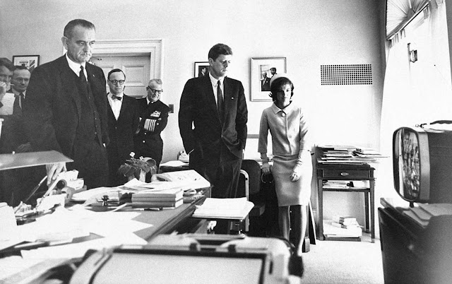 President Kennedy and Mrs. Jacqueline Kennedy follow the takeoff and space flight of Astronaut Alan Shepard on television. Others, watching from the White House office of the Chief Executive's secretary in Washington, on May 5, 1961, are, from left: Attorney General Robert Kennedy; McGeorge Bundy, presidential assistant; Vice President Lyndon Johnson; Arthur Schlesinger Jr., another presidential assistant, and Chief of Naval Operations Adm. Arleigh Burke.