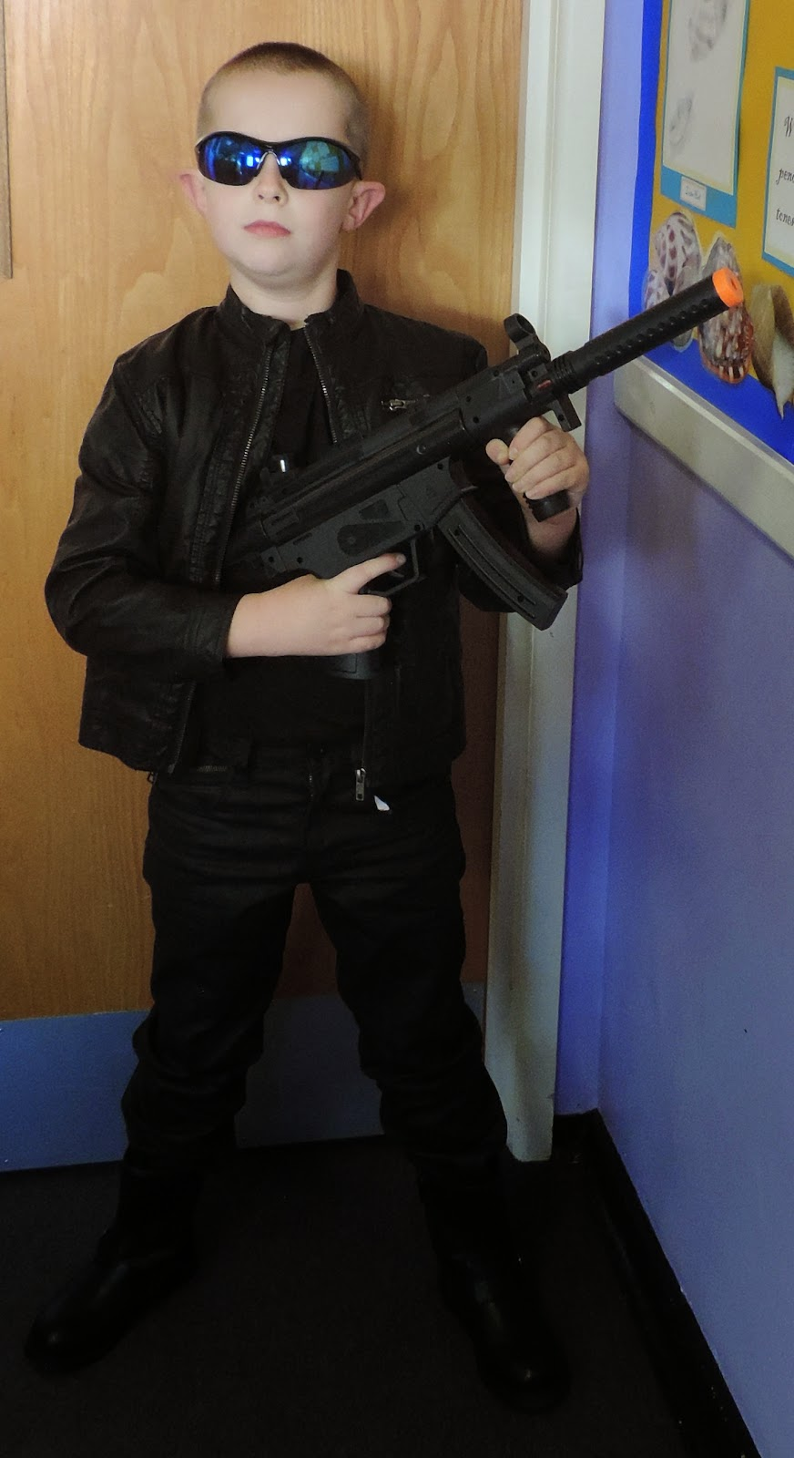 boy dressed as schwarzenegger Terminator cosplay