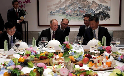 Vladimir Putin at a working dinner with President of China Xi Jinping.