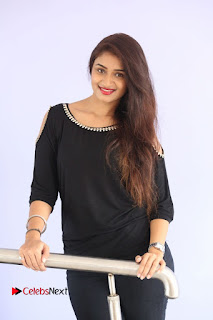 Actress Kiran Chetwani Pictures in Black Jeans at Lakshmidevi Samarpinchu Nede Chudandi Platinum Disc Function  0083.JPG