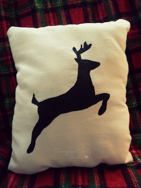 Black silhouette reindeer pillow