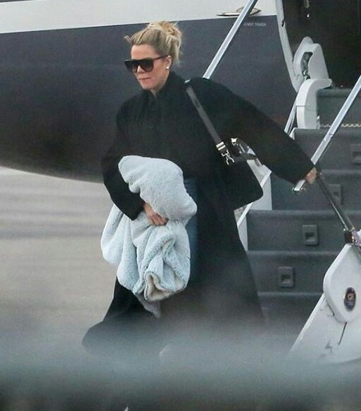 Pregnant Khloe Kardashian shows first sign of tiny baby bump as she arrives San Francisco with her sisters