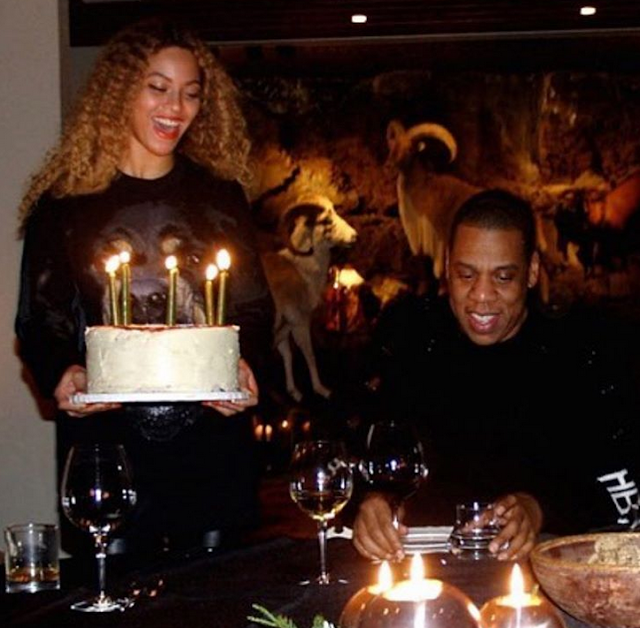 Jay Z gets cake from his wife Beyonce as they celebrate his 48th birthday...