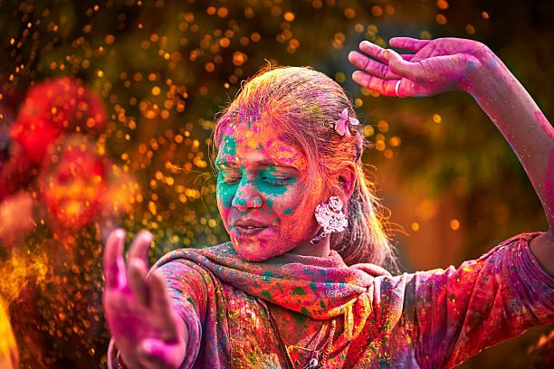 girl celebrating holi 2018