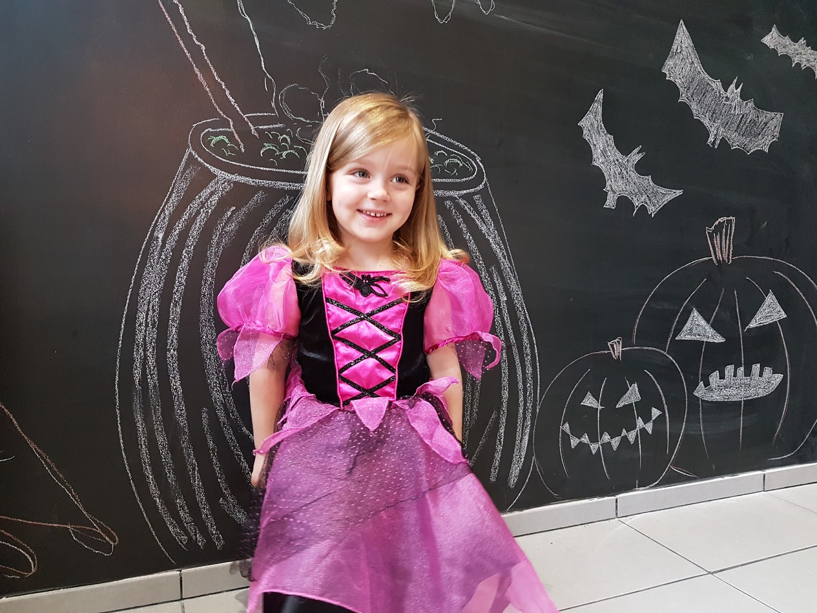 toddler girl wearing a pink and black Halloween dress