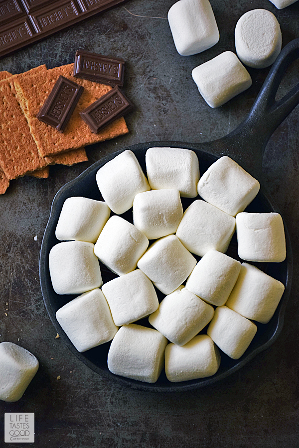 Skillet S'mores Dip   by Life Tastes Good. This indoor s'mores recipe is an easy recipe with just 4 ingredients and ready in only 5 minutes. No campfire needed! Great for a quick snack, dessert, or party appetizer. #LTGrecipes