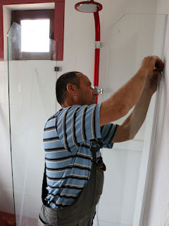 Bekir trying to fit the shower enclosure