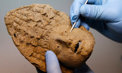Clay theatrical mask found in ancient burial chamber