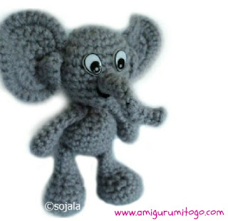 grey crochet elephant with comical eyes