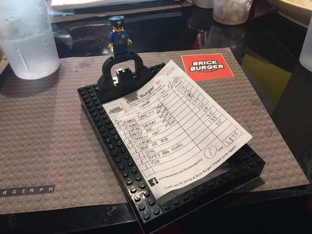 Your bill comes in a LEGO tray with minifig
