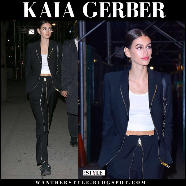 Kaia Gerber in black zip blazer and black zip trousers alexander wang model style may 5