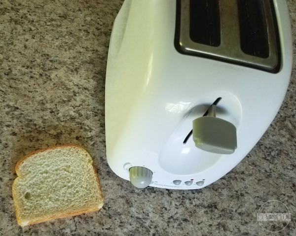 simple radiation and conduction experiment for kids using a toaster, knife,  and bread