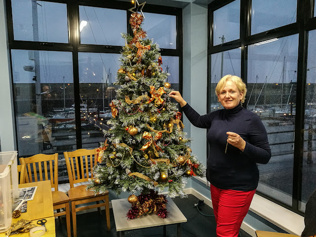 Photo of me decorating the marina Christmas tree