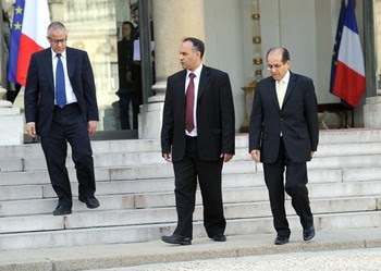 Mahmud Jibril (right ) and Ali al-Essawi (center) of Libya's rebel national council, and Ali Zeidan (Left ), envoys from Libya's opposition leave on March 10, 2011 the Elysee presidential palace, after a meeting with France's president Nicolas Sarkozy