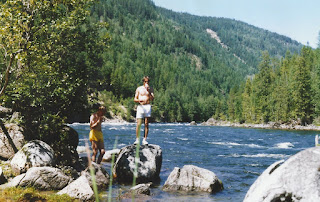 Craig and myself standing on rocks by the Clearwater River during our epic bike journey