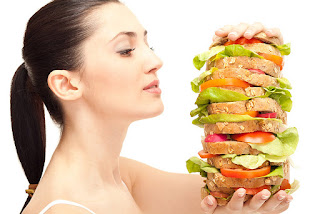 Woman eating huge sandwich