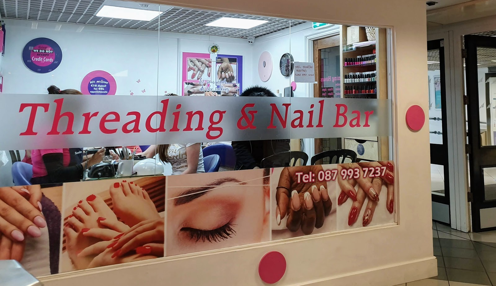 Galway Threading and Nail bar -phone   087 993  7237.   Exterior window, with pictures of the work they do on nails and eyebrows.
