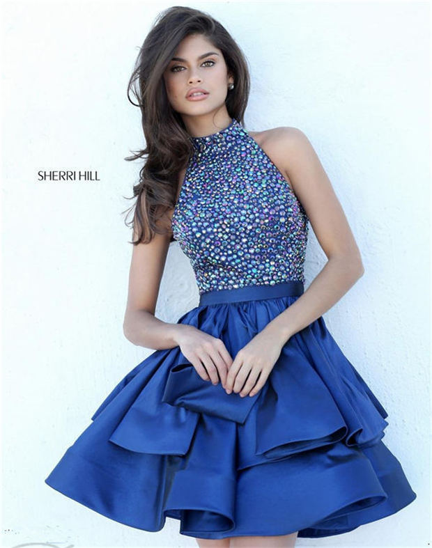 6cc7df83660 Let your unique and shiny beauty stand out in this shiny Sherri Hill 50711  tiered skirt homecoming dresses. This cocktail dress offers a halter high  ...