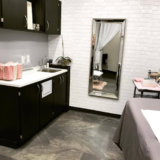 image of a waxing salon interior including counter and table, Blush Waxing Boutique