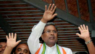 Karnataka CM sacks 14 ministers, inducts 13