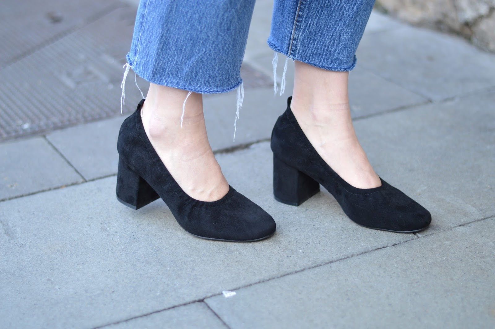 Frayed denim jeans and block heel ballet pumps