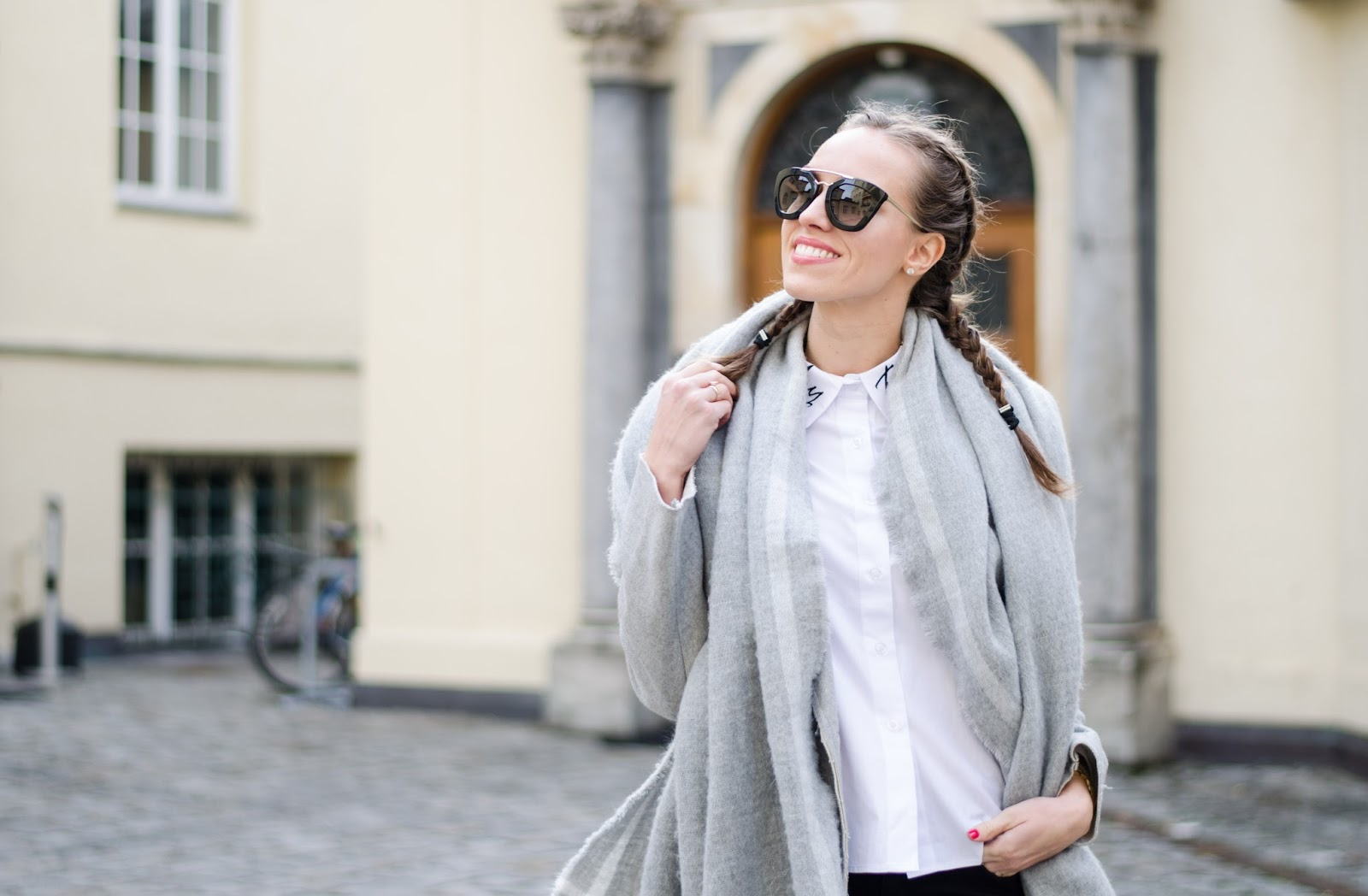 kristjaana mere gray wool coat white collar shirt french braids