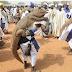 See men backing crocodiles in Northern Nigeria