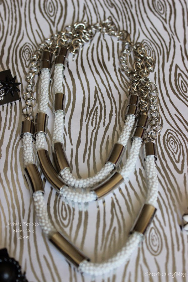 picture of a white beading necklace from Cocoa Jewelry
