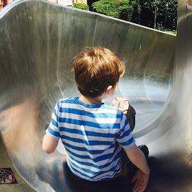Autistic David on a slide