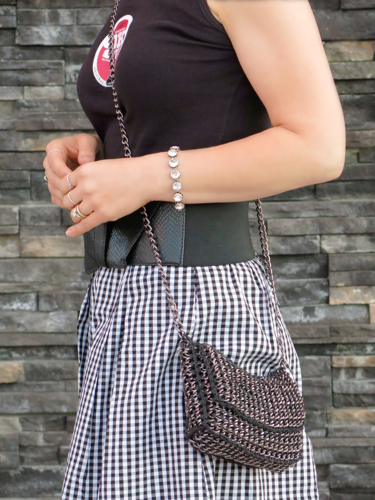styling a black-and-white gingham skirt with a Dayton tank, extra-wide belt, and accessories