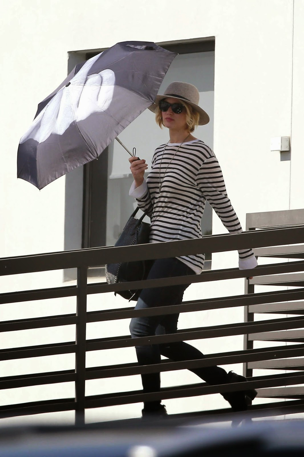 Jennifer Lawrence in skinny jeans and a striped top out and about in LA
