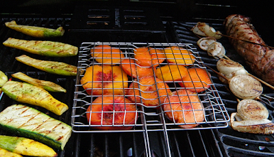 squash, onion, peaches, and meat on grill