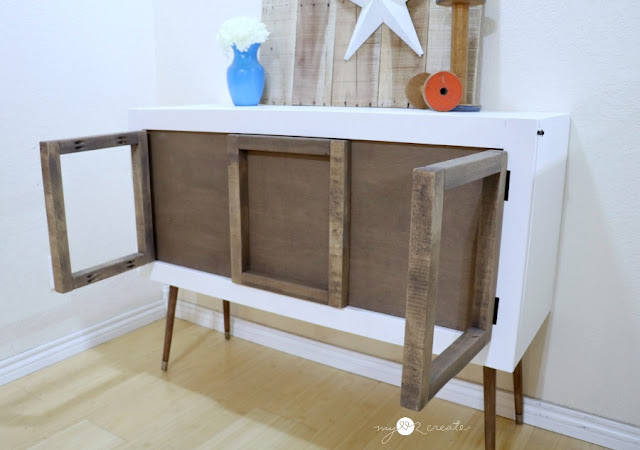 credenza with frames that swing out as legs for a hidden kids pull down table
